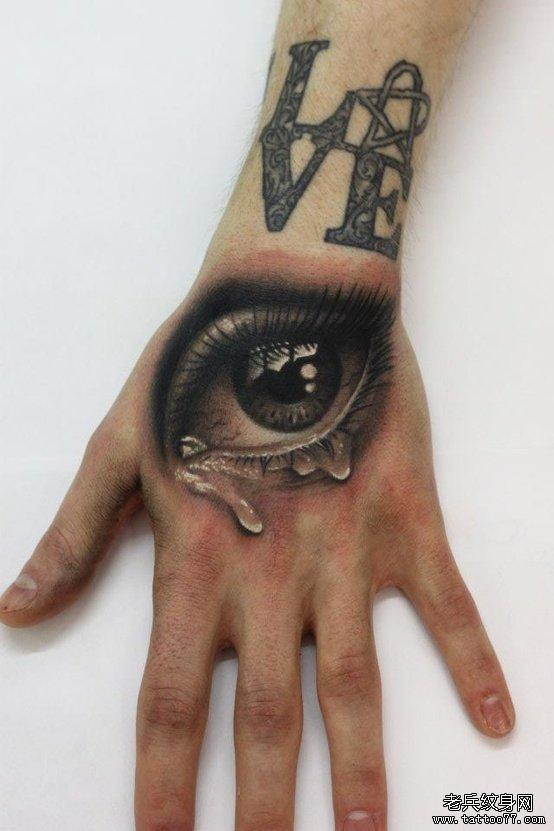 手臂时尚的流泪的眼睛纹身图案
