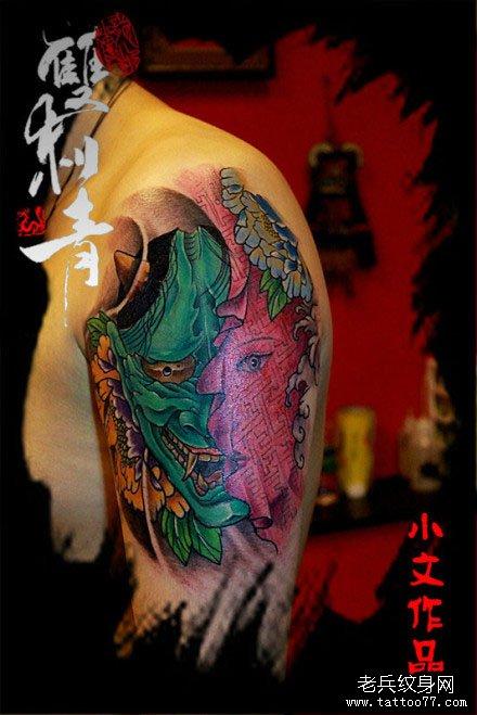 手臂一款潮流经典的彩色般若纹身图案