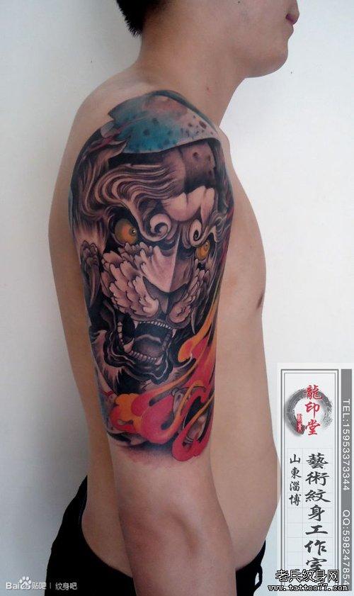男人手臂帅气很酷的唐狮子纹身图案
