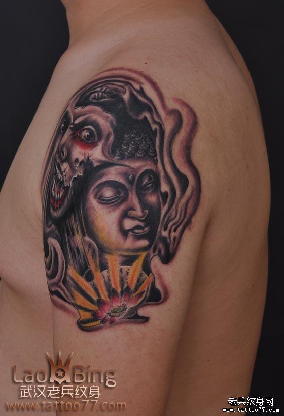武汉纹身老兵刺青手臂佛魔纹身图案图片