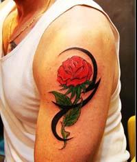武汉老兵纹身店:手臂玫瑰图腾纹身图案作品