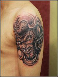 大臂黑白佛魔纹身图案作品