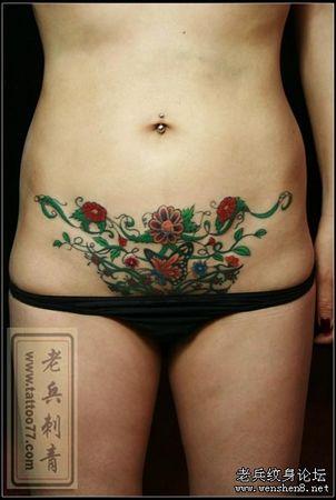 腹部纹身图案:美女腹部彩色蝴蝶花卉藤蔓纹身图案纹身图片
